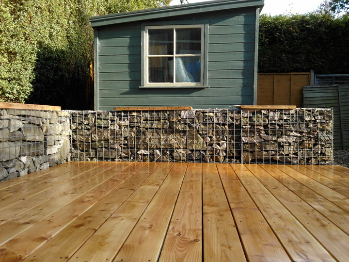 Decking with gabion baskets.